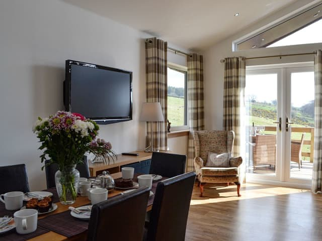 Woodburn Holiday Lodges - image of living room with dining table