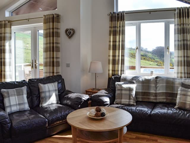 Woodburn Holiday Lodges - image of living room