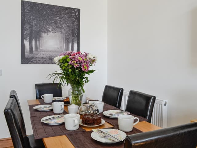 Woodburn Holiday Lodges - image of dining table